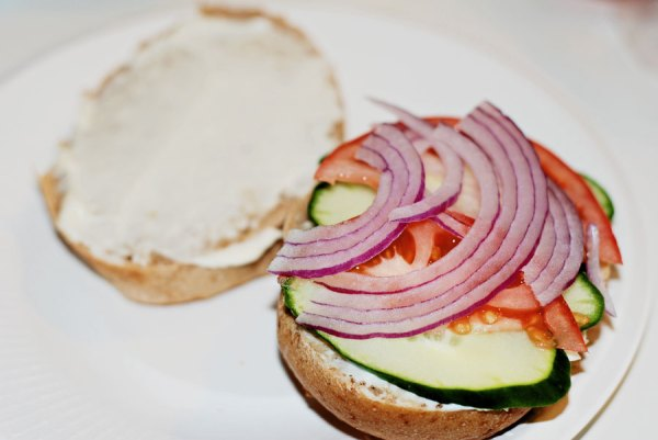 A whole wheat bun with cucumbers, tomato and red onion.  I'm already slobbering!